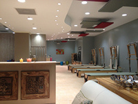 Treating the ceiling or ceiling hardware with acoustic baffles is an